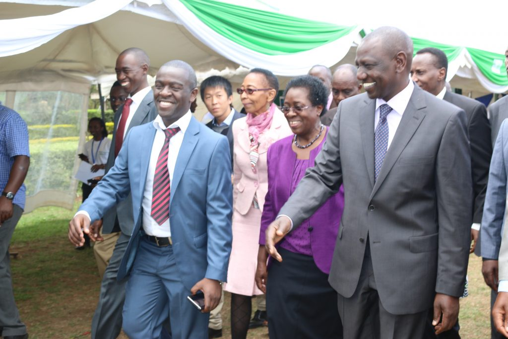 Mr. Calvin Kebati (left) walks the Vice Chancellor, the Kenyan Deputy President Hon. William Ruto in a tour of different stands at the JKUAT Tech Expo in 2014.