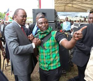 President Uhuru Kenyatta with Pitson at JKUAT graduation square during the University's 201th Anniversary celebrations last year.