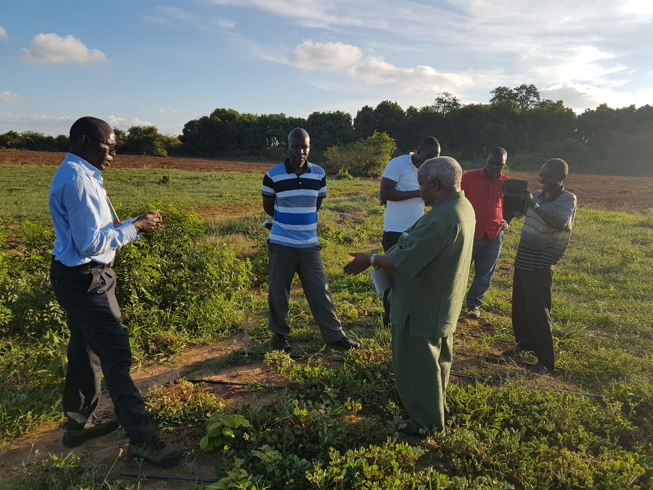 Dr. Chris Ojiewo (left) during an undertaking to monitor Implementation of Program Improvement (PIPs) of groundnuts in Tanzania. This falls under the Tropical Legumes III program of his work.