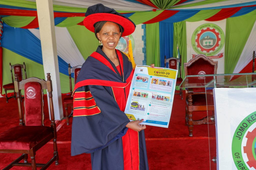 Dr. Agnes Mercy Wahome, first person in Kenya to attain a PhD Health communication degree show casing the various research materials that she used.
