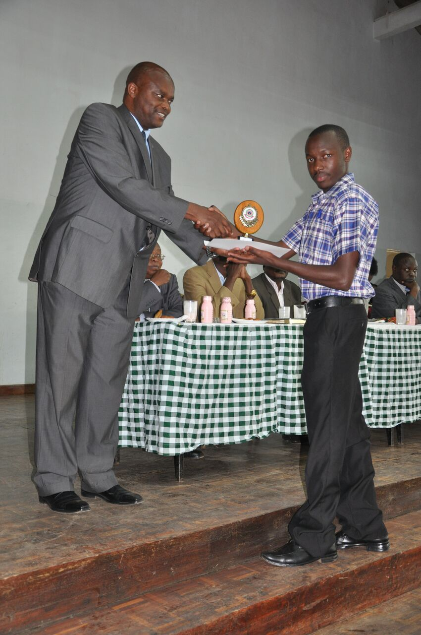 Peter Macharia, receiving his BABAROA award for the 2011-2012 academic year.