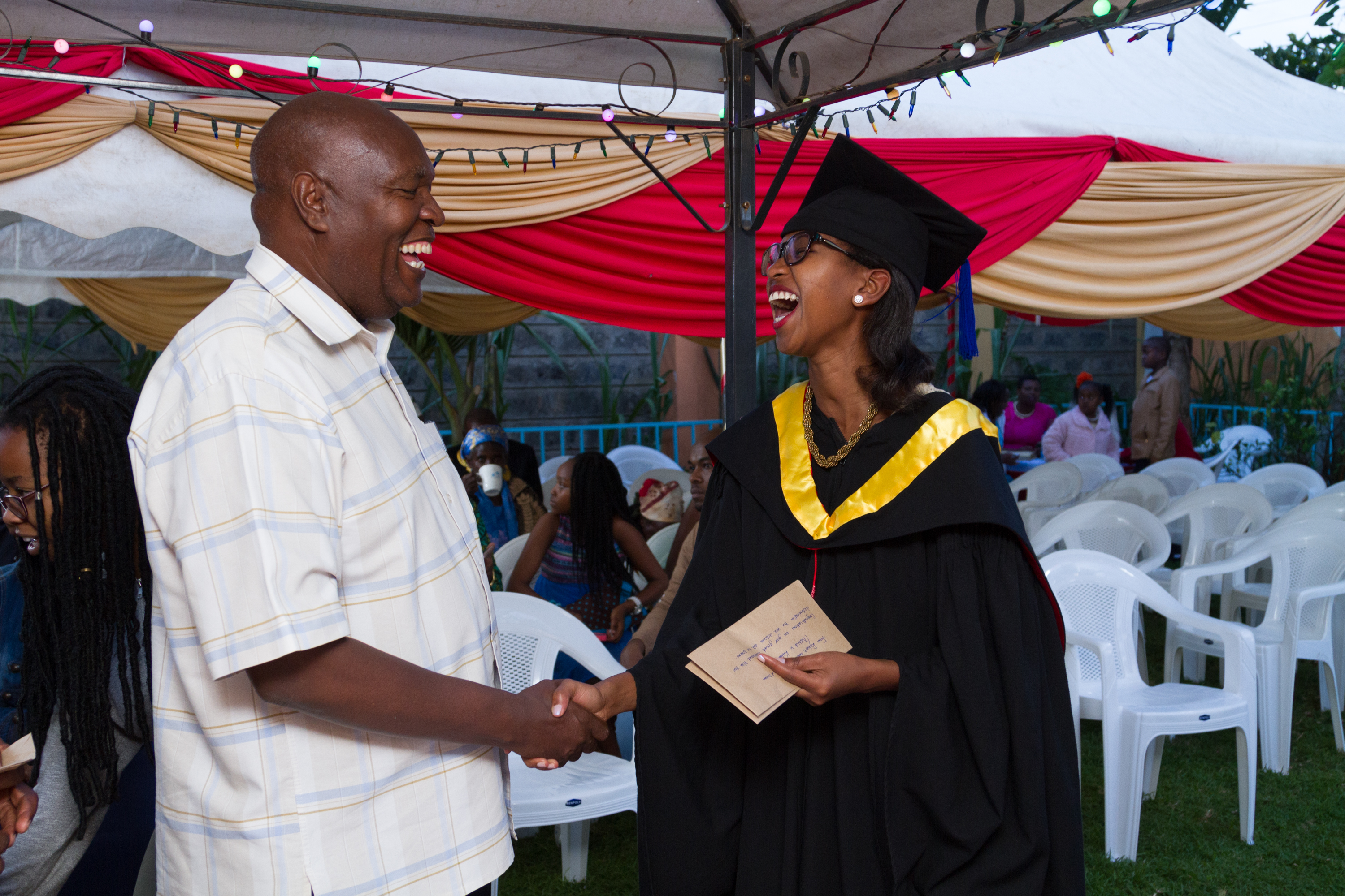 Ms. Betty is congratulated by Senior Lecturer, Eng. Benson Kariuki after her graduation.