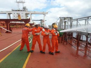 Joseph Ng'aru, (second from left) doing a fire fighting drill on the ship alongside other Marine Engineers