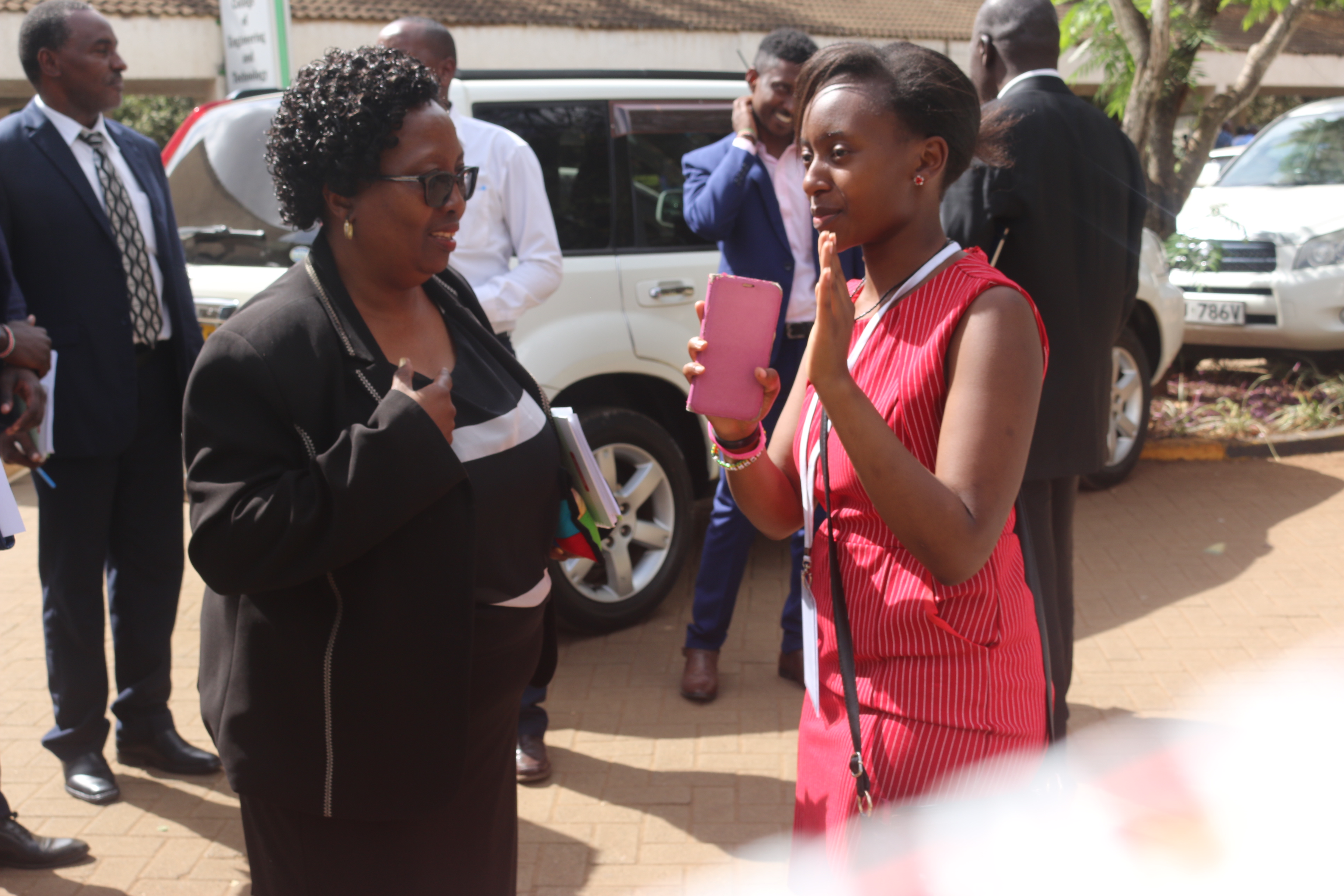 Ms. Claire Wahome confers with the VC, Prof. Victoria Ngumi before giving her a tour of the health drive