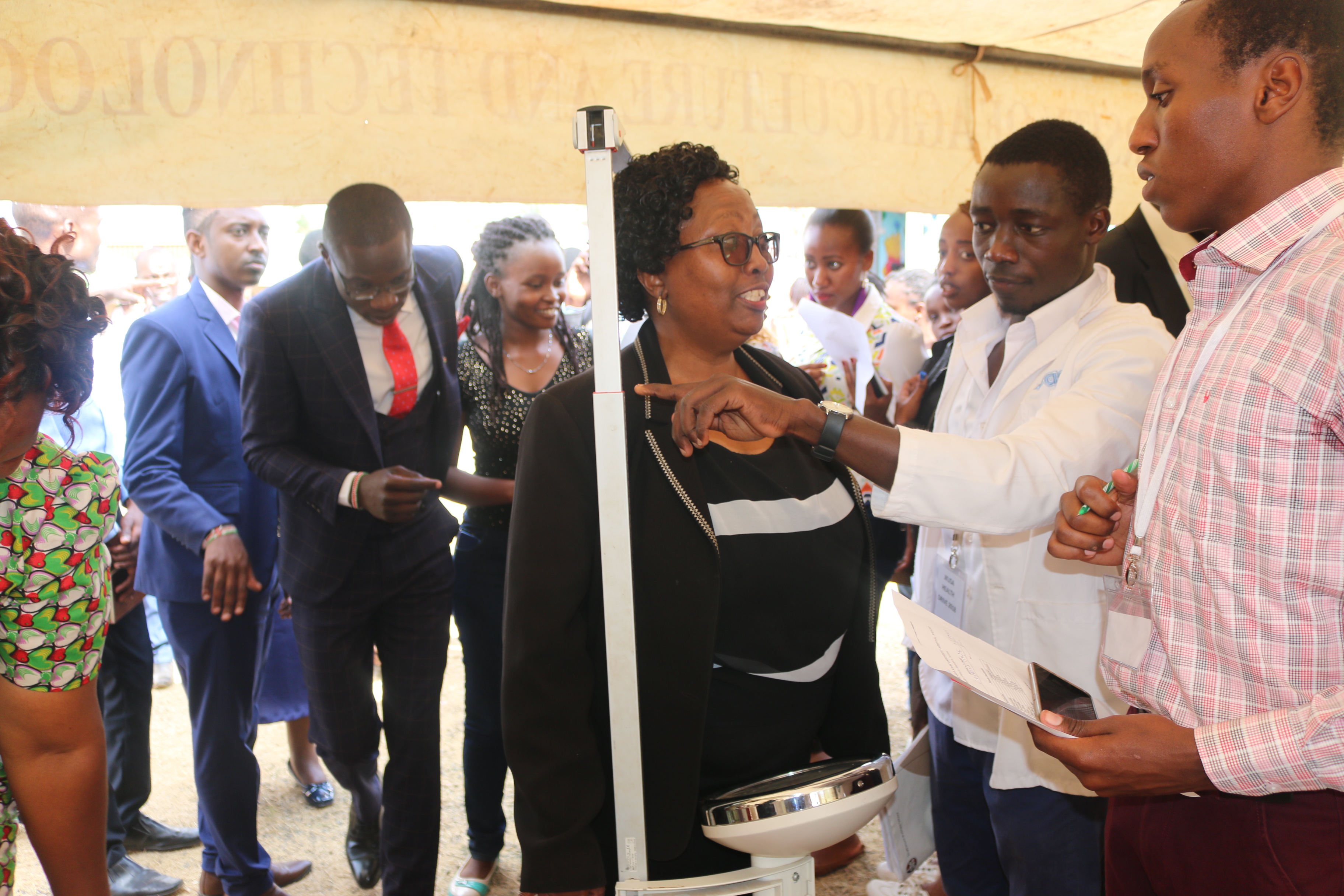 The Vice Chancellor participates at the health drive by checking her vitals.