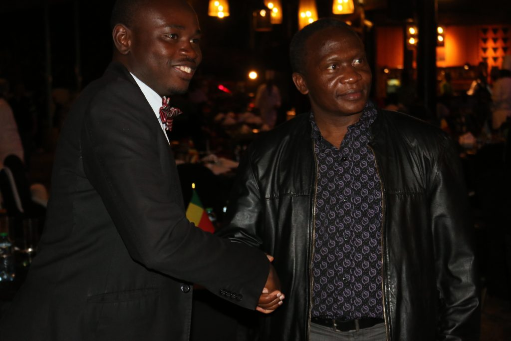 Mr. Ayorinde (left) shaking hands with the PAUSTI Director Prof. Gabriel Magoma at the graduates dinner.