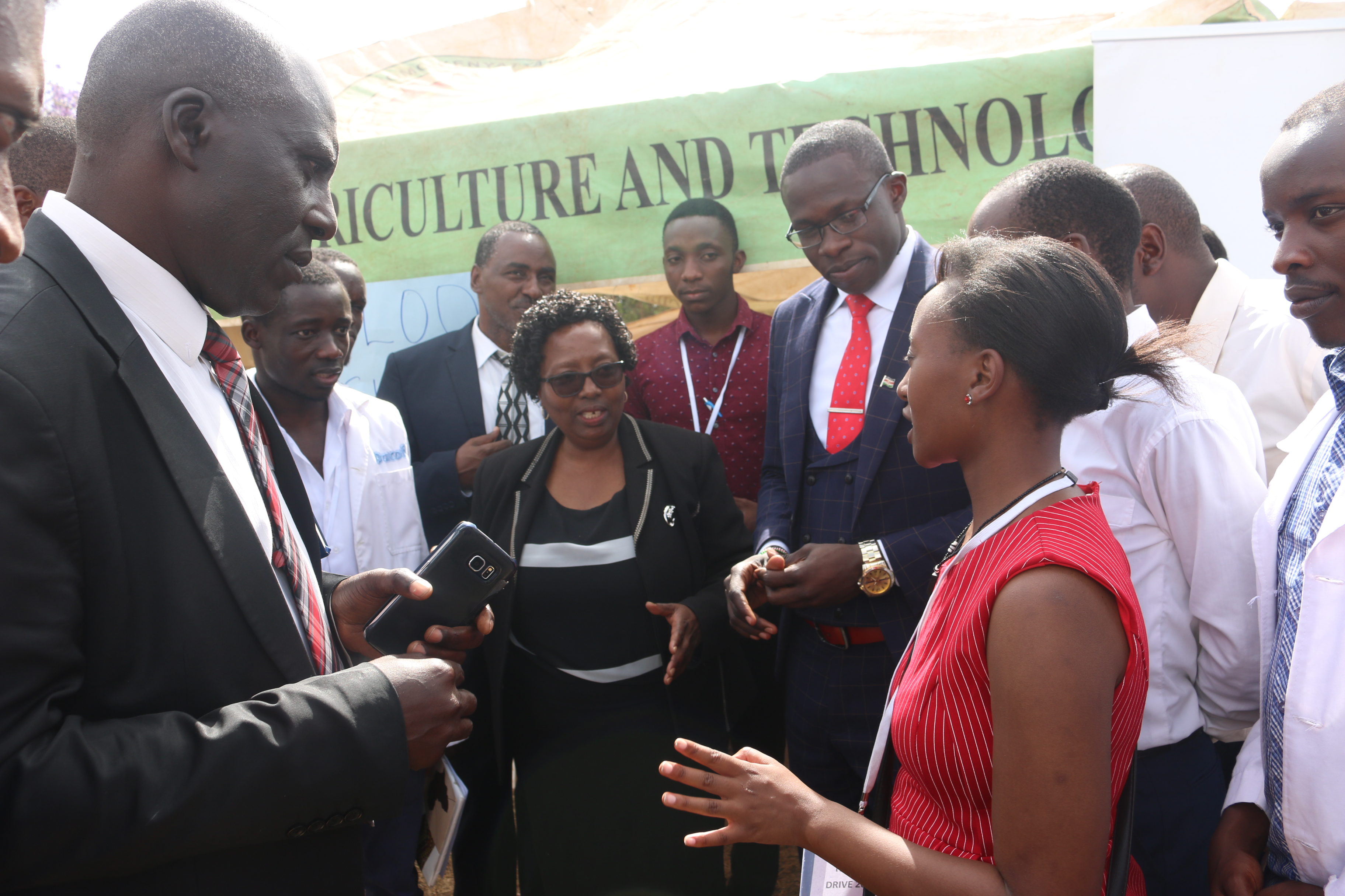 Ms. Claire Wahome explains a point to the VC Prof. Ngumi, and the DVC Finance Prof. Moirongo.
