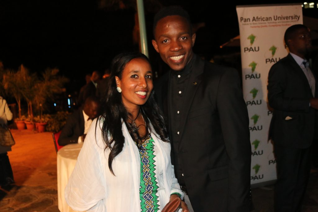 Ms. Hulubanche poses for a photo with Mr. Gbohounme Tawanou of Benin at the graduates dinner.