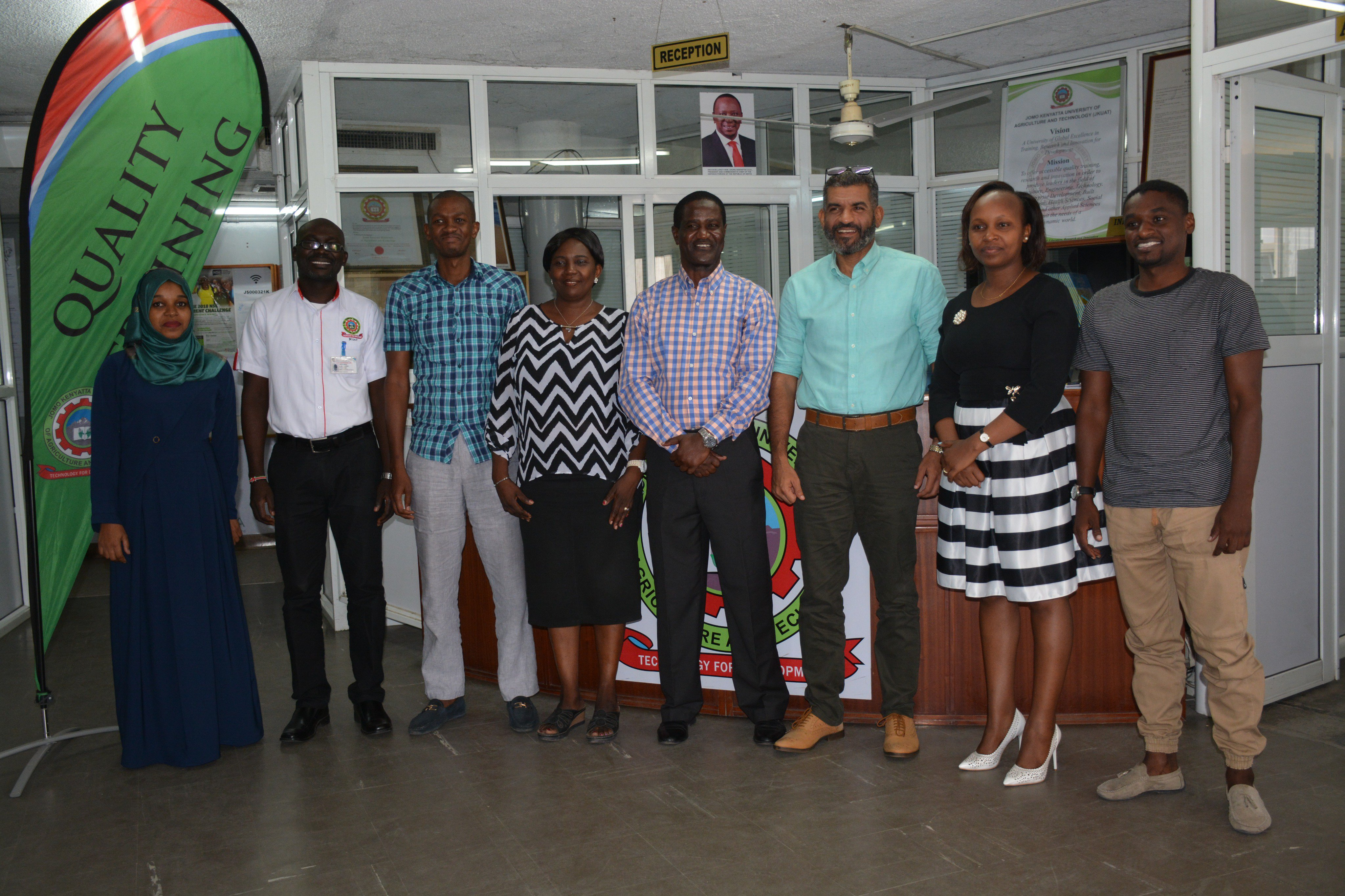 Dr. Fridah poses for a photo with Mvita MP and staff members in 2018 after partnership talks to set up Constituency Innovation Hub.