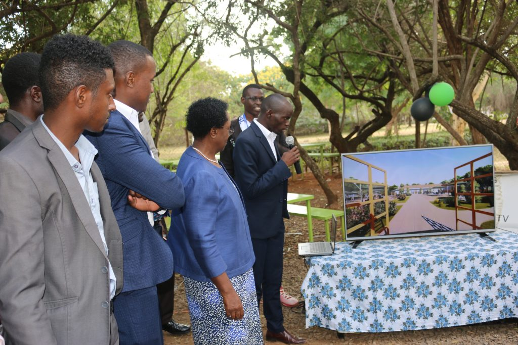 Vice Chancellor Prof. Mabel Imbuga is taken through the blueprint of the new Centre