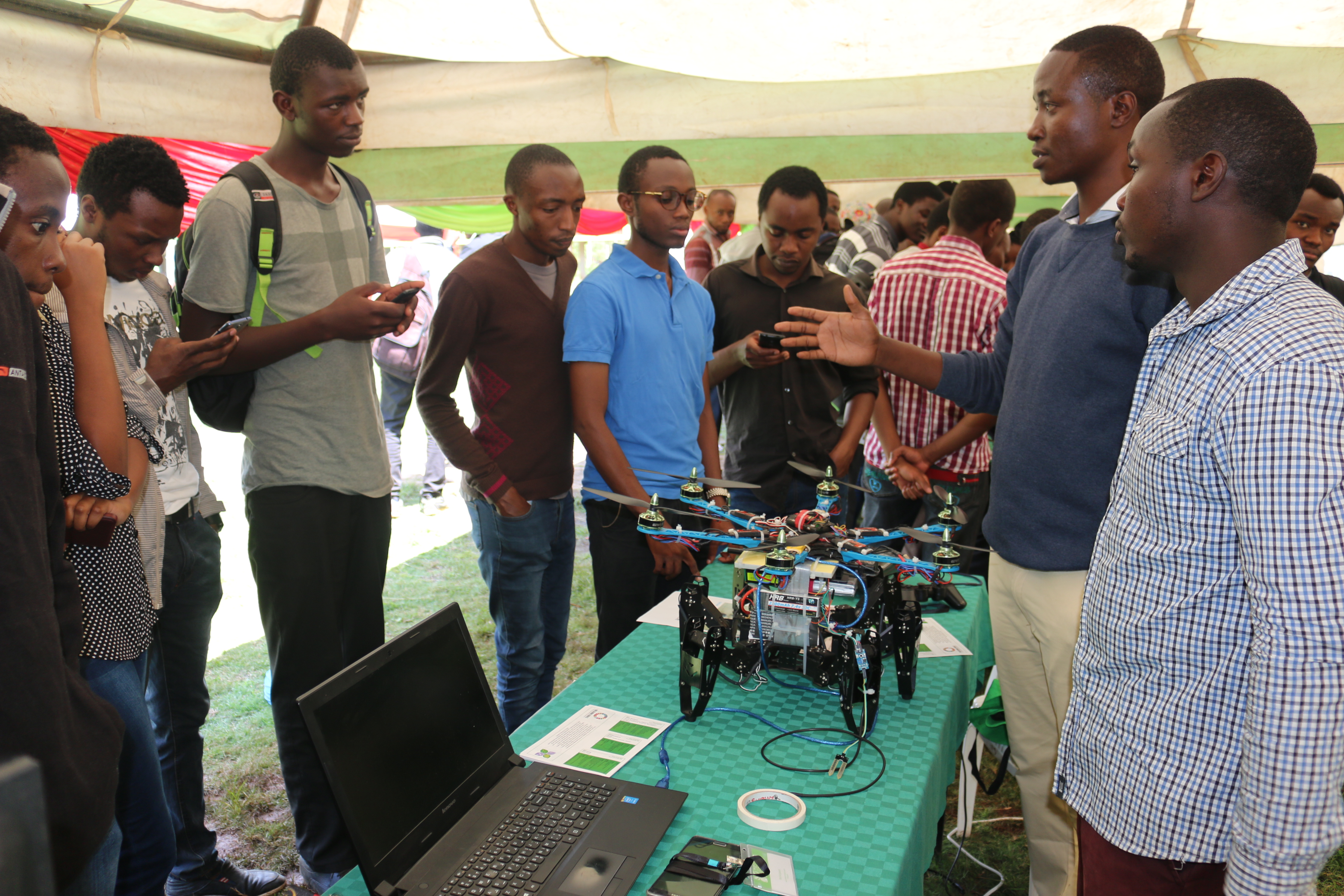 Charles explains his innovation to attendees at the Expo last year.