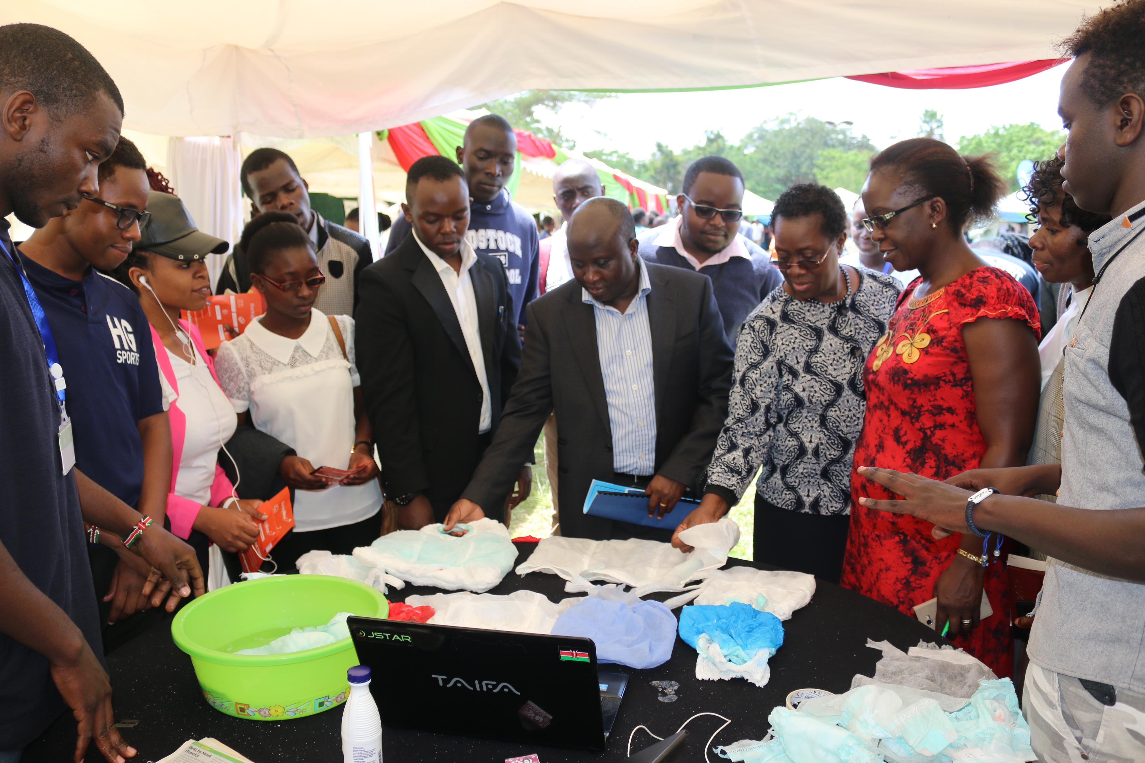 Top University management led by Council member Eng. John Tanui and VC Prof. Mabel Imbuga marvel at the 'Begi bora' project at last year's Tech Expo
