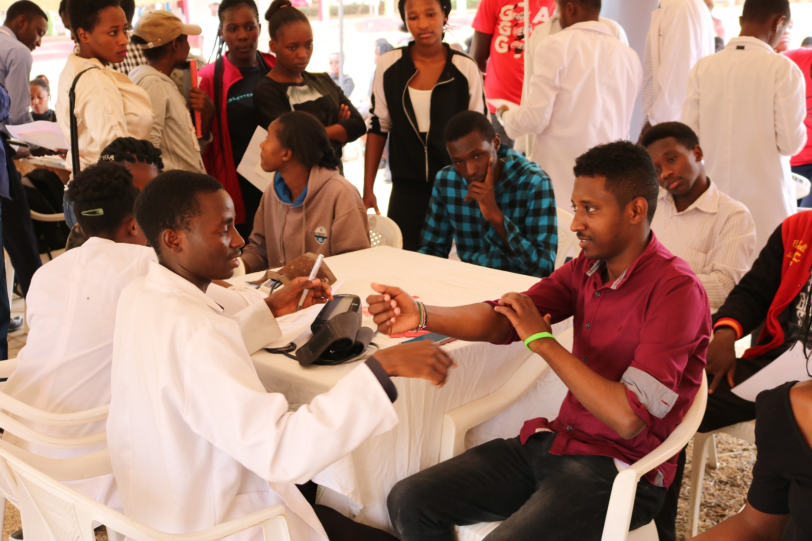 JKUSA-Chaiperson-Ibrahim Boru-right-taking blood-sugar test during the drive