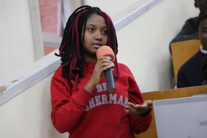 Emma Mwanza, a third year BSc. Development Studies, makes her contribution at the forum.