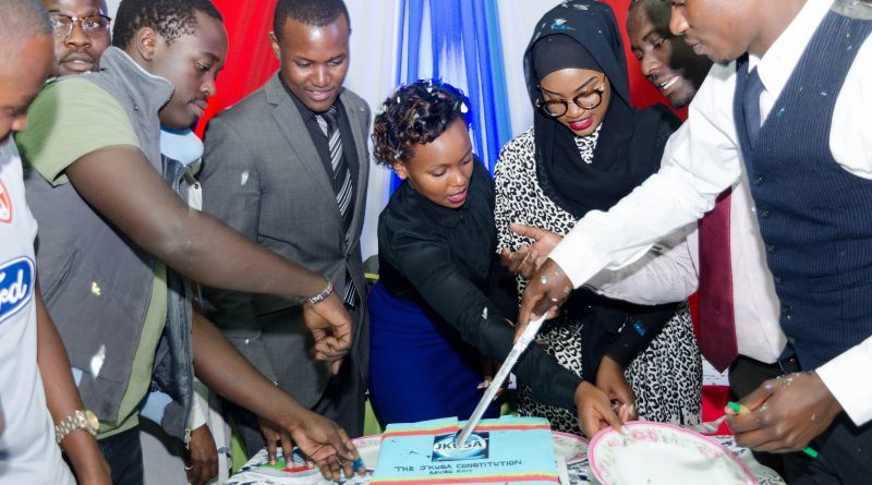 Student Leaders, Committee Members and students cutting the cake to mark the promulgation of the JKUSA Constitution