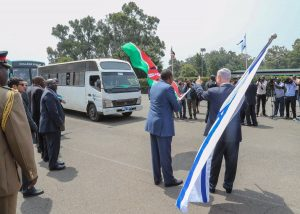 President Uhuru Kenyatta and the Israeli PM Benjamin Netanyahu symbolically flag off buses carrying the students at State House Nairobi.