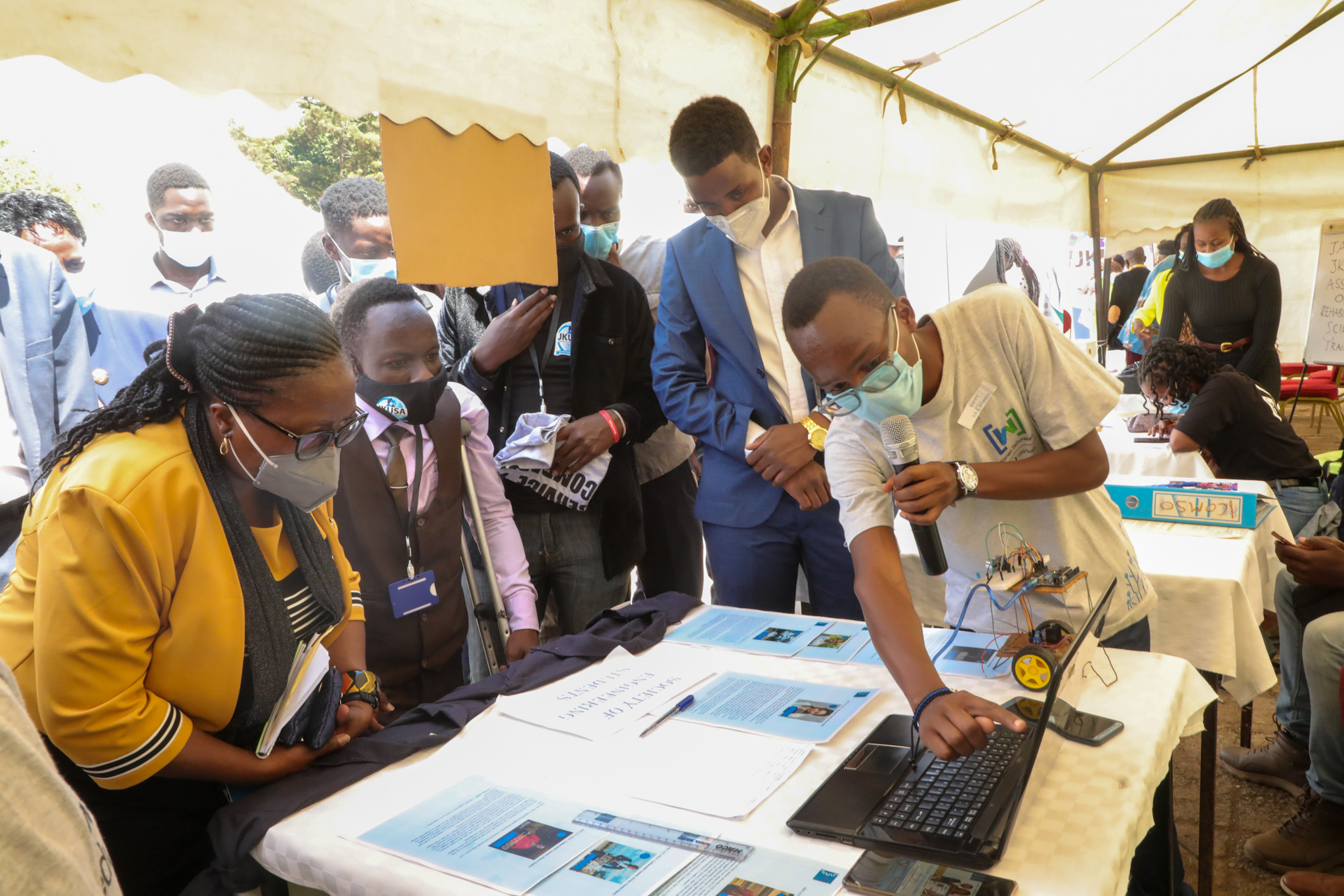 Jeff Mboya a member of the Society of Engineering Students (SES) showcasing their project to the Vice Chancellor, Prof. Victoria Ngumi.